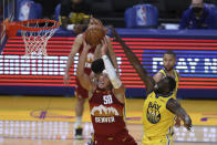 Denver Nuggets' Aaron Gordon, left, shoots against Golden State Warriors' Draymond Green during the second half of an NBA basketball game in San Francisco, Friday, April 23, 2021. (AP Photo/Jed Jacobsohn)