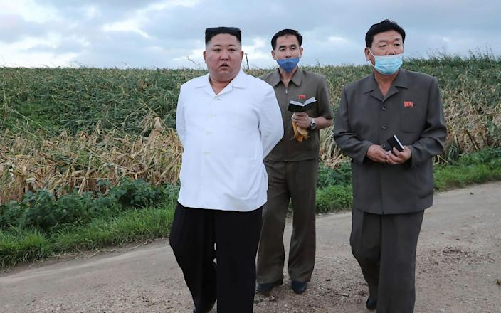 Kim Jong-un has visited a province badly hit by a typhoon this week - AFP