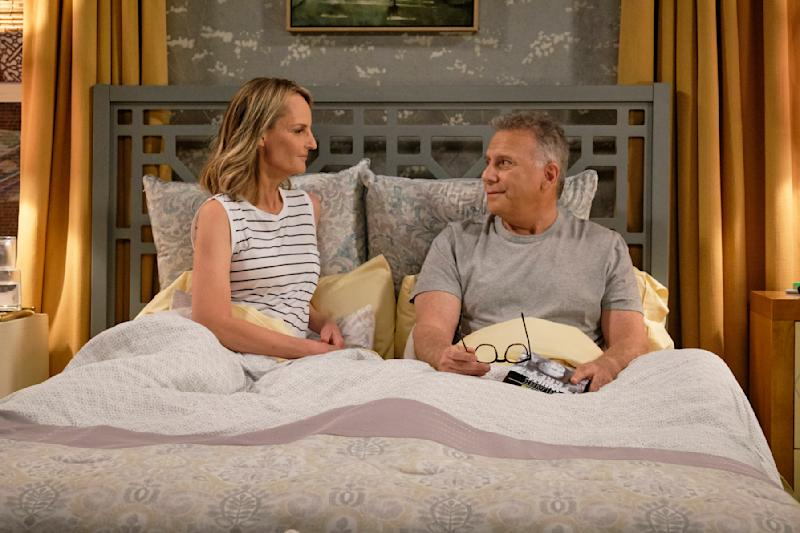 """This image released by Sony Pictures Television/Spectrum Originals shows Paul Reiser, right, and Helen Hunt in a scene from """"Mad About You,"""" a reboot of the 1990s comedy series. The limited series debuts Wednesday on Spectrum Originals for on-demand subscribers. (Trae Patton/Sony Pictures Television/Spectrum Originals via AP)"""