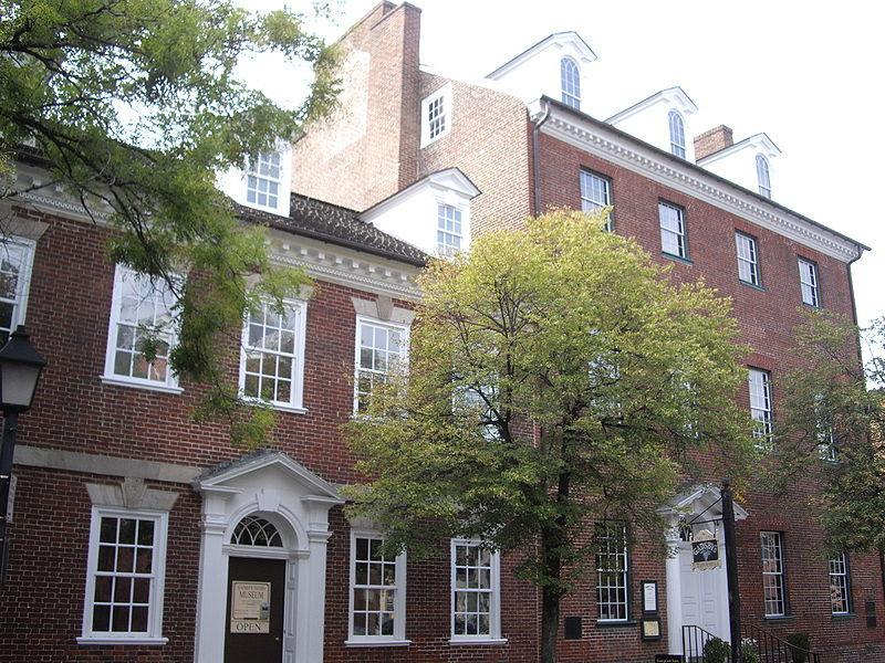 "<p>Originally built around 1785, Gadsby's Tavern in Alexandria, Va., is today home to several businesses including <a href=""http://www.gadsbystavernrestaurant.com/"">Gadsby's Tavern Restaurant</a>, which resides in the tavern's original dining room. The building is said to be haunted by the ghost of an unknown young woman who died in Room 8 after a three-week illness. She'd been traveling with her husband, who refused to reveal his or his wife's identity throughout their stay. After her death, the husband arranged for an extravagant burial, only to skip out on the bill soon after. Visitors say they've seen the <a href=""http://www.connectionnewspapers.com/news/2005/oct/26/who-was-she/"">woman standing with a candle at the window of Room 8</a>, or walking by her nearby tombstone, which is dedicated <a href=""https://en.wikipedia.org/wiki/Female_Stranger"">to the ""Female Stranger.""</a> <i>(Photo: <a href=""https://commons.wikimedia.org/wiki/File:Gadsbys-tavern.JPG"">Wikimedia Commons</a>)</i></p>"