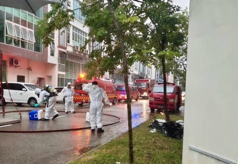 The Johor Fire and Rescue Department's Hazmat unit decontaminates the Johor Department of Environment's (DoE) premises at Taman Tampoi Indah 2 in Johor Baru March 21, 2019. — Picture courtesy of Johor Fire and Rescue Department