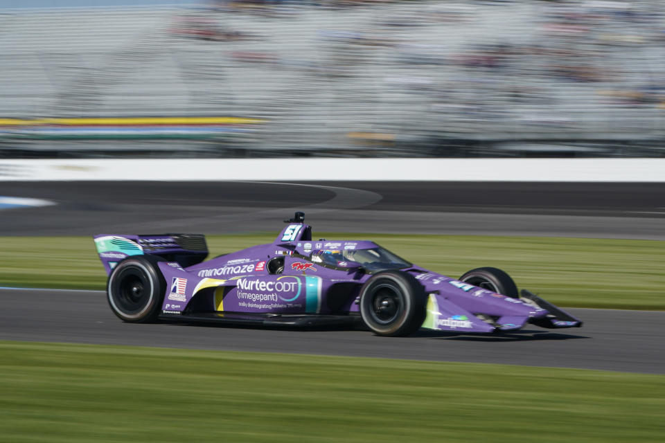 Romain Grosjean of Switzerland drives during practice for the IndyCar auto race at Indianapolis Motor Speedway in Indianapolis, Friday, May 14, 2021. (AP Photo/Michael Conroy)