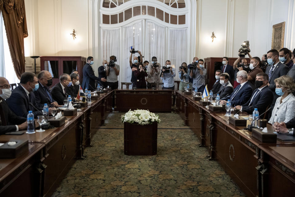 Egyptian Foreign Minister Sameh Shoukry, third from left, meets with Israeli Foreign Minister Gabi Ashkenazi, second from right, at the Tahrir Palace in Cairo, Egypt, Sunday, May 30, 2021. (AP Photo/Nariman El-Mofty)