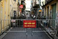 Hanoi is now divided into tiny segments, with movement between each extremely difficult (AFP/Manan VATSYAYANA)