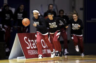 The Stanford women's NCAA college basketball team enter the court prior to their game against Oregon in Santa Cruz, Calif., Friday, Jan. 8, 2021. (AP Photo/Jed Jacobsohn)