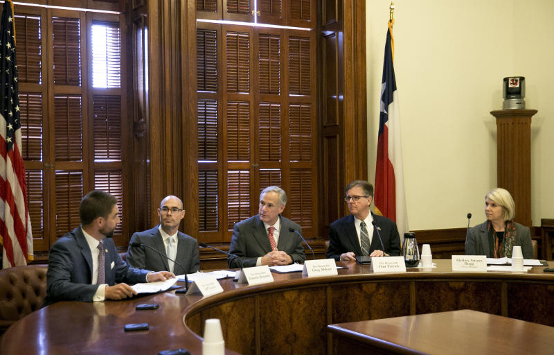 Members of the State Preservation Board, left to right, state Rep. Jeff Leach, R-Plano, House Speaker Dennis Bonnen, R-Angleton, Gov. Greg Abbott, Lt. Gov. Dan Patrick and citizen board member Aletha Swann Bugg vote to remove the Children of the Confederacy Creed plaque from the Capitol during a meeting of the State Preservation Board at the Capitol on Friday January 11, 2019. ( Jay Janner/Austin American-Statesman via AP)