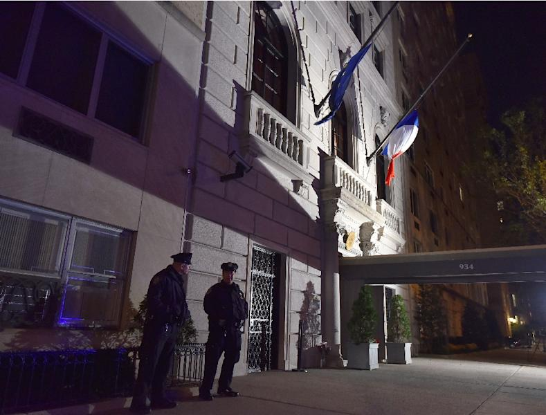 French flags fly at half mast at the French Consulate in New York on November 13, 2015 as US police went on heightened alert after attackers killed at least 120 people in Paris (AFP Photo/Louis Lanzano)