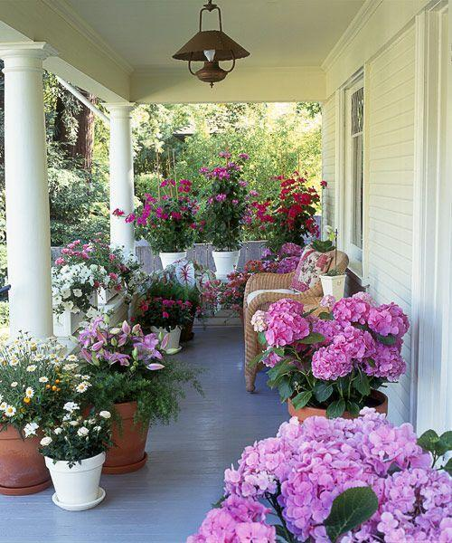 <p>Relocate pots of lush flowers as a fast way to perk up a deck before a party. With a limited palette, like the pink and white blooms here, the collection feels cohesive, not chaotic.</p>