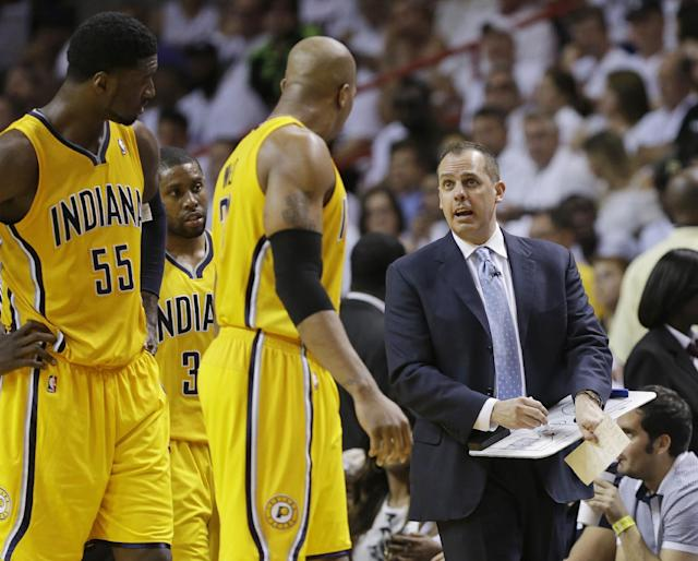 Indiana Pacers coach Frank Vogel speaks to David West, center, Roy Hibbert (55) and C.J. Watson (32) during a timeout in the second half of Game 3 in the NBA basketball Eastern Conference finals playoff series against the Miami Heat, Saturday, May 24, 2014, in Miami. (AP Photo/Lynne Sladky)