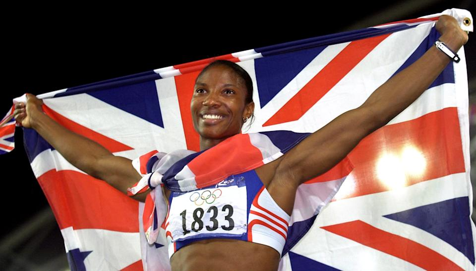 Great Britain's Denise Lewis celebrates winning the Gold medal in the Women's Heptathlon at the Olympic Games in Sydney, Australia. 30/12/2000: Lewis to be awarded an OBE for services to athletics in the Queen's New Years Honours list.  *  2/11/01: The golden girl of British athletics Denise Lewis is pregnant, it was announced. The West-Bromwich born heptathlete and her partner Belgian sprinter Patrick Stevens are expecting their first child in April 2002. Her agent said Miss Lewis, 29, was delighted, is set to continue a planned training programme during pregnancy and after the birth intends to resume training full time.   (Photo by John Giles - PA Images/PA Images via Getty Images)