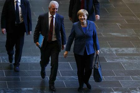 German Chancellor and leader of the Christian Democratic Union party (CDU) Angela Merkel arrives next to party fellow Stanislaw Tillich for preliminary coalition talks between Germany's conservative (CDU/CSU) parties and the Social Democratic Party (SPD) at the Parliamentary Society in Berlin October 14, 2013. REUTERS/Tobias Schwarz