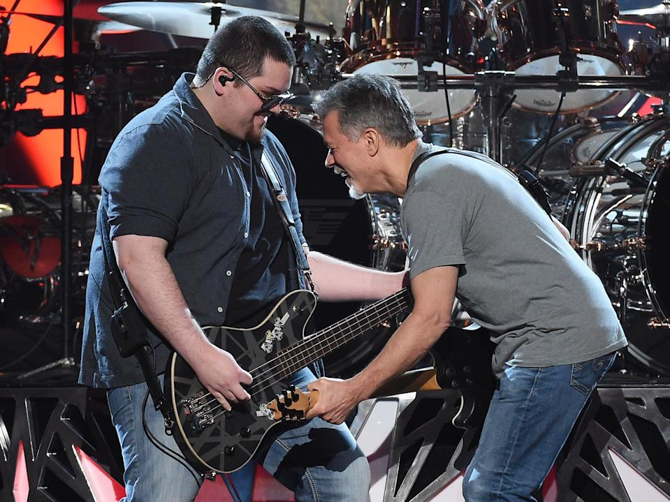Bassist Wolfgang Van Halen (L) and guitarist Eddie Van Halen of Van Halen perform during the 2015 Billboard Music Awards (Getty Images)