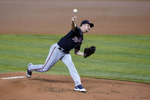 Washington Nationals' Erick Fedde pitches during the first inning of the first game of a baseball doubleheader against the Miami Marlins, Friday, Sept. 18, 2020, in Miami. (AP Photo/Wilfredo Lee)