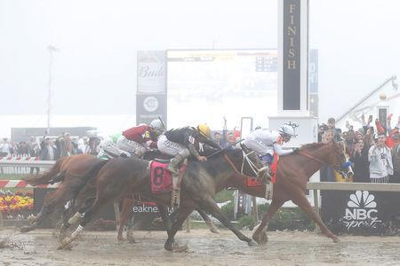 FILE PHOTO - May 19, 2018; Baltimore, MD, USA; Mike Smith aboard Justify (7) wins the 143rd running Preakness race at Pimlico Race Course. Mandatory Credit: Amber Searls-USA TODAY Sports