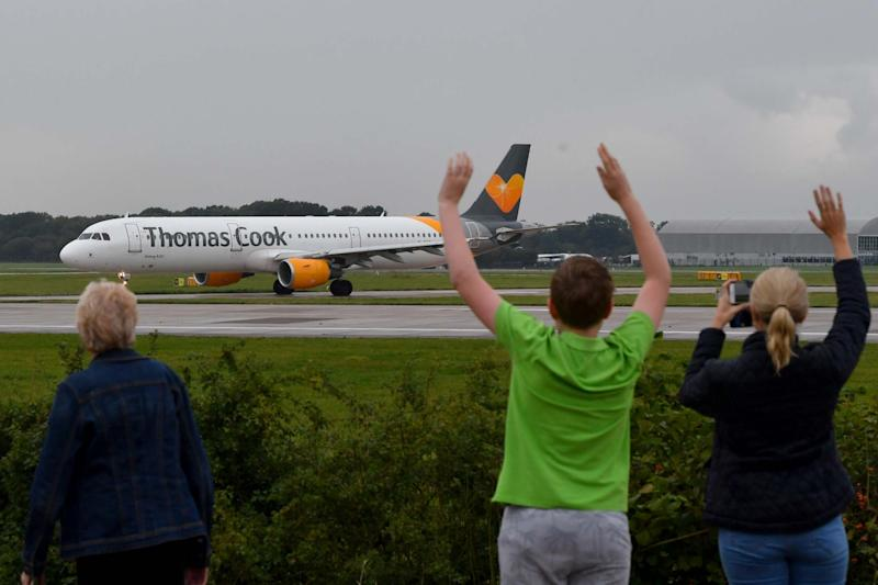 The pilot's family members wave as a Thomas Cook aircraft departs from Manchester Airport with the travel giant's future still uncertain: Getty