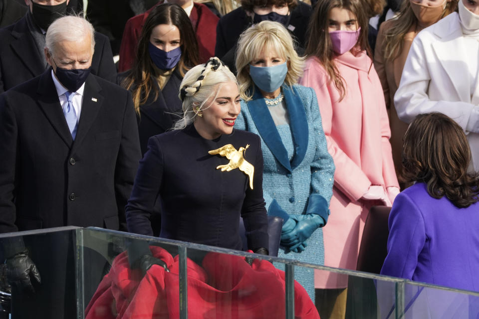 Lady Gaga arrives to sing the National Anthem during the 59th Presidential Inauguration at the U.S. Capitol in Washington, Wednesday, Jan. 20, 2021. (AP Photo/Andrew Harnik)