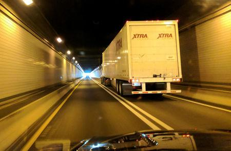 FILE PHOTO: A transport truck passes through the Allegheny Mountain Tunnel in Somerset County, Pennsylvania, U.S. on September 3, 2017.   REUTERS/Hyungwon Kang/File Photo