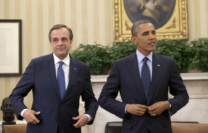 """President Barack Obama and Greek Prime Minister Antonis Samaras talk during their meeting in the Oval Office of the White House in Washington, Thursday, Aug. 8, 2013. The White House said the meeting will """"underscore ongoing support for Greece's efforts to reform its economy and promote a return to prosperity.""""(AP Photo/Pablo Martinez Monsivais)"""