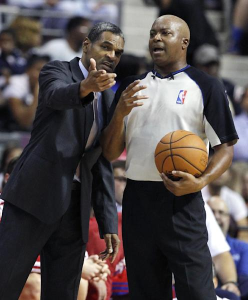 Detroit Pistons coach Maurice Cheeks, left, argues a call with NBA official Olandis Poole in the first half of an NBA basketball preseason game on Thursday, Oct. 10, 2013, in Detroit. (AP Photo/Duane Burleson)