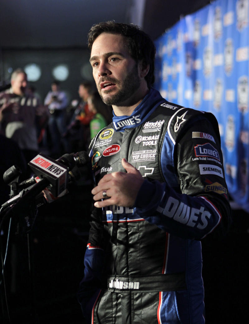 Driver Jimmie Johnson answers questions on auto racing during NASCAR media day at Daytona International Speedway in Daytona Beach, Fla., Thursday, Feb. 10, 2011.(AP Photo/John Raoux)