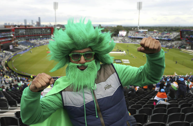 A Pakistan cricket fan poses for a photo in the stands prior to the start of play in the ICC Cricket World Cup group stage match between India and Pakistan, at Emirates Old Trafford stadium in Manchester, England, Sunday June 16, 2019. (Martin Rickett/PA via AP)