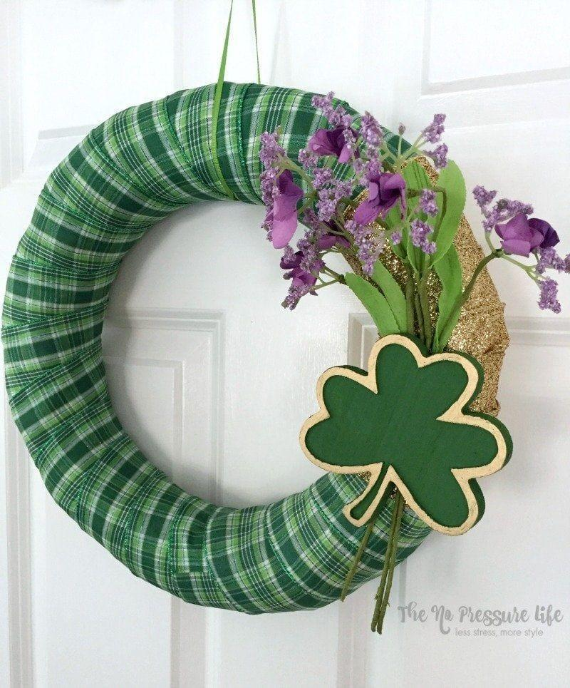 "<p>Green checkered ribbon over a wreath form gives this pretty project Irish appeal, especially when combined with the wooden shamrock.</p><p><strong>Get the tutorial at <a href=""https://www.thenopressurelife.com/st-patricks-day-wreath/"" rel=""nofollow noopener"" target=""_blank"" data-ylk=""slk:The No Pressure Life"" class=""link rapid-noclick-resp"">The No Pressure Life</a>.</strong></p><p><a class=""link rapid-noclick-resp"" href=""https://www.amazon.com/Apple-Barrel-Acrylic-Assorted-Colors/dp/B003EUB7JQ/ref=as_li_ss_tl?tag=syn-yahoo-20&ascsubtag=%5Bartid%7C10050.g.35162910%5Bsrc%7Cyahoo-us"" rel=""nofollow noopener"" target=""_blank"" data-ylk=""slk:SHOP GREEN CRAFT PAINT"">SHOP GREEN CRAFT PAINT</a><br></p>"