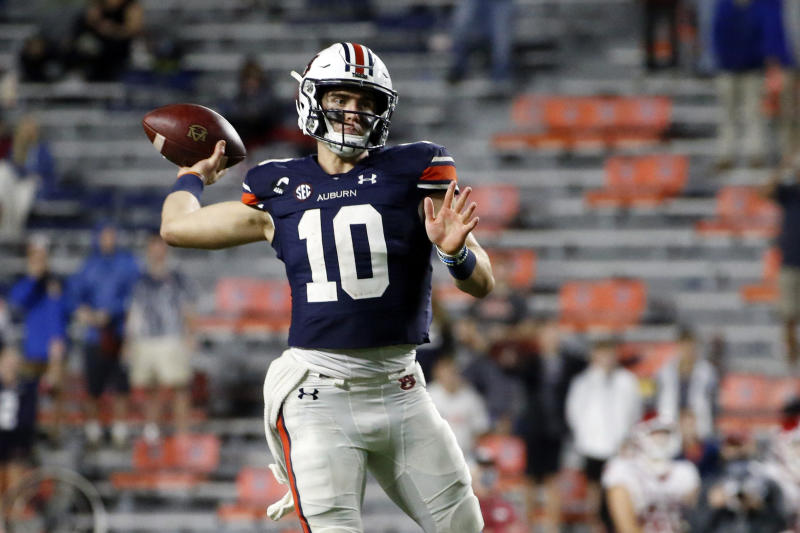 Auburn quarterback Bo Nix throws a pass against Arkansas during the second half of an NCAA college football game Saturday, Oct. 10, 2020, in Auburn, Ala. (AP Photo/Butch Dill)