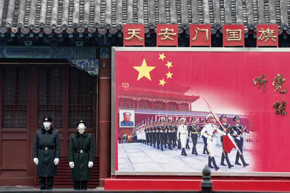 Members of the People's Liberation Army (PLA) honour guard stand next to a banner near the Forbidden City in Beijing, China.