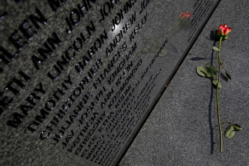 A rose sits on the base of the main headstone in the Lockerbie Air Disaster memorial garden in Lockerbie, Scotland