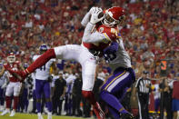Kansas City Chiefs wide receiver Marcus Kemp catches a pass as Minnesota Vikings safety Myles Dorn defends during the first half of an NFL football game Friday, Aug. 27, 2021, in Kansas City, Mo. (AP Photo/Ed Zurga)