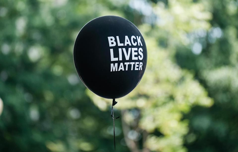 A Black Lives Matter ballon is seen at the Navy Memorial to support Black Lives Matter during the Black Mamas March a protest against police brutality and racial inequality in the aftermath of the death of George Floyd on June 27, 2020 in Washington, DC. (Photo by Michael A. McCoy/Getty Images)