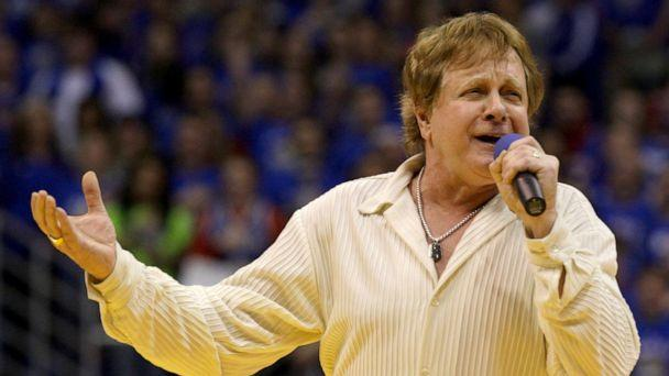 PHOTO: Eddie Money sings the national anthem before an NCAA college basketball game between Kansas and Missouri in Lawrence, Kan., Jan. 25, 2010. (Charlie Riedel/AP, FILE)