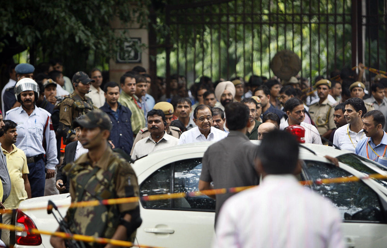 Indian Home Minister P. Chidambaram, center wearing glasses, inspects the site of a blast outside the High Court in New Delhi, India, Wednesday, Sept. 7, 2011. A bomb hidden in a briefcase exploded Wednesday outside a crowded entrance to a New Delhi courthouse, the deadliest attack in India's capital in nearly three years. (AP Photo/Mustafa Quraishi)