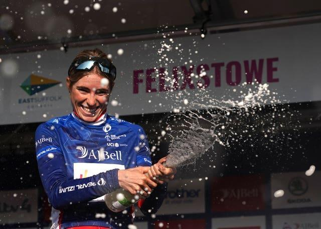 Demi Vollering celebrates on the podium after winning the Women's Tour