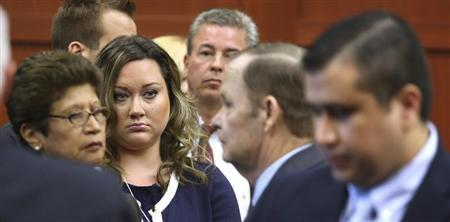 George Zimmerman's wife, Shellie, watches her husband leave the courtroom during a recess in his trial at the Seminole circuit court in Sanford