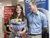 <p>Kate, holding flowers, laughs with Will at an event celebrating World Mental Health Day. <br></p>
