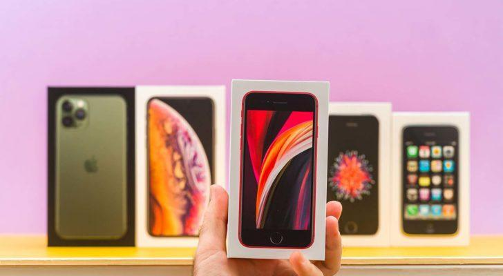 A close-up shot of different Apple (AAPL) iPhones in front of a purple background. stocks to buy