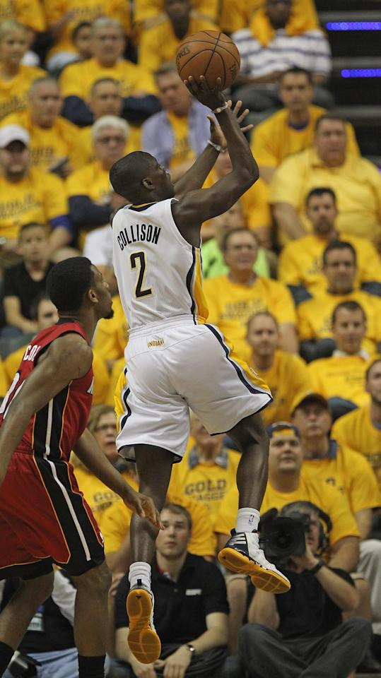 INDIANAPOLIS, IN - MAY 17: Darren Collison #2 of the Indiana Pacers goes up for a shot past Norris Cole #30 of the Miami Heat in Game Three of the Eastern Conference Semifinals in the 2012 NBA Playoffs at Bankers Life Fieldhouse on May 17, 2012 in Indianapolis, Indiana. NOTE TO USER: User expressly acknowledges and agrees that, by downloading and/or using this photograph, User is consenting to the terms and conditions of the Getty Images License Agreement.  (Photo by Jonathan Daniel/Getty Images)