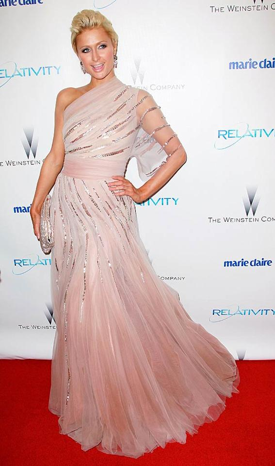 """Paris Hilton made her grand entrance at a post-Globes bash wearing a sequined pale pink Jean Fares Couture gown, which she accessorized with a sparkling Christian Louboutin clutch and Bruman earrings. """"I felt like a princess"""" she tweeted of her night in the ethereal dress. David Livingston/<a href=""""http://www.gettyimages.com/"""" target=""""new"""">GettyImages.com</a> - January 16, 2011"""