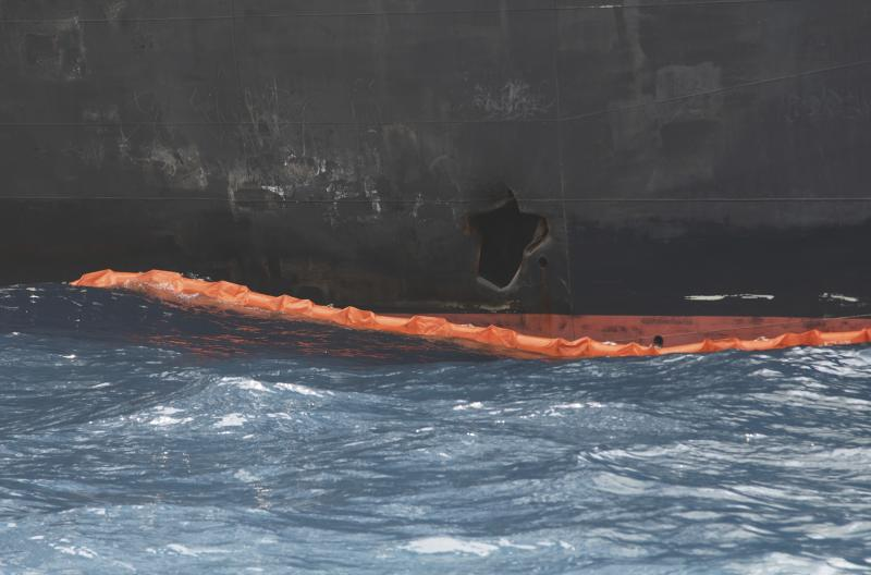 """A hole the U.S. Navy says was made by a limpet mine is seen on the damaged Panama-flagged, Japanese owned oil tanker Kokuka Courageous, anchored off Fujairah, United Arab Emirates, during a trip organized by the Navy for journalists, on a Wednesday, June 19, 2019. The limpet mines used to attack the oil tanker near the Strait of Hormuz bore """"a striking resemblance"""" to similar mines displayed by Iran, a U.S. Navy explosives expert said Wednesday. Iran has denied being involved. (AP Photo/Fay Abuelgasim)"""