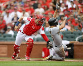 St. Louis Cardinals catcher Andrew Knizner, left, tags out Pittsburgh Pirates' Adam Frazier, right, during the first inning of a baseball game Sunday, Aug. 11, 2019, in St. Louis. (AP Photo/Scott Kane)