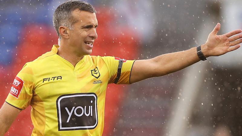NRL referee Matt Cecchin is pictured awarding a try.