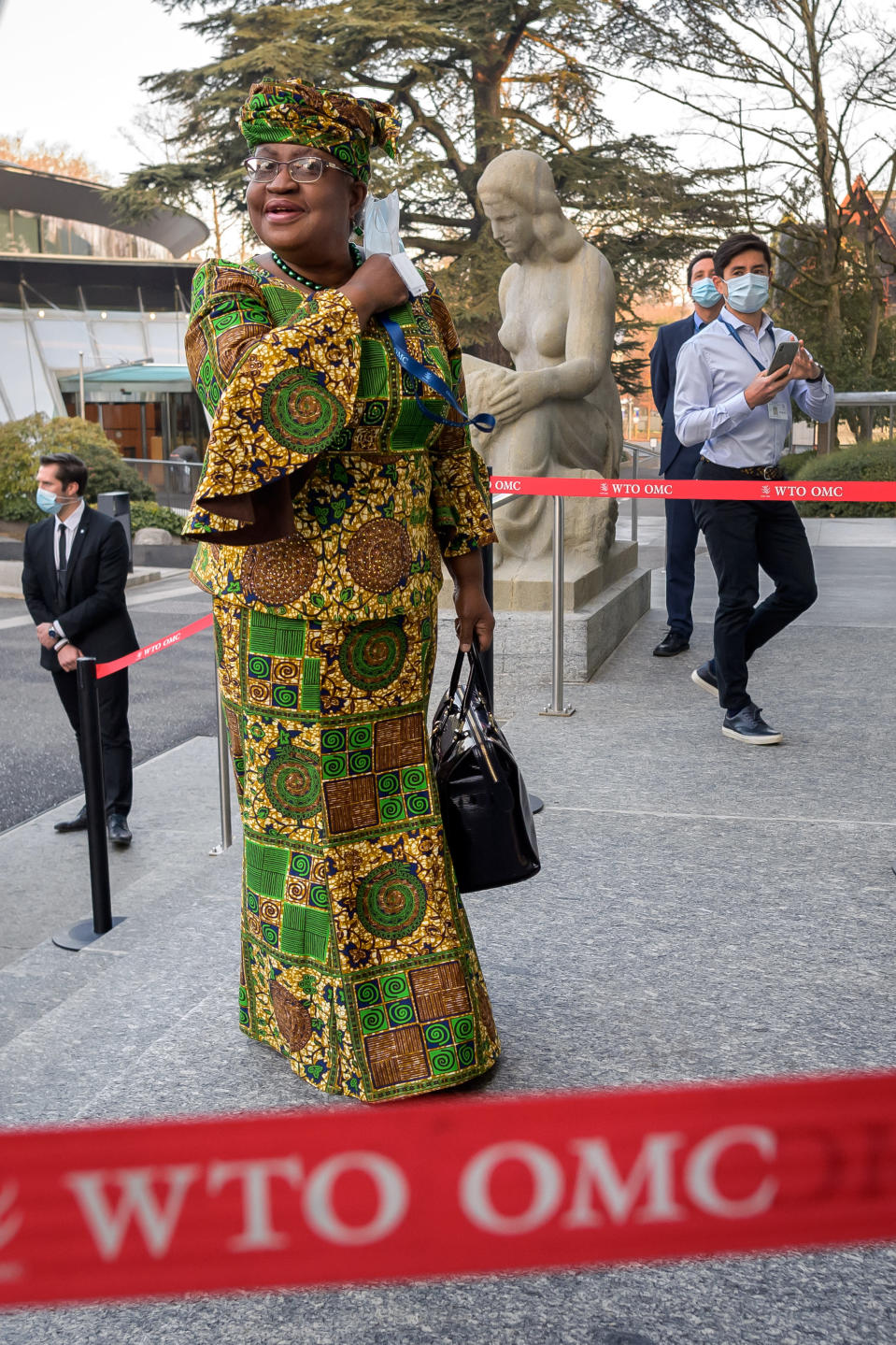 New Director-General of the World Trade Organisation (WTO) Ngozi Okonjo-Iweala arrives at the WTO headquarters to takes office in Geneva, Switzerland, Monday, March 1, 2021. Nigeria's Ngozi Okonjo-Iweala takes the reins of the WTO amid hope she will infuse the beleaguered body with fresh momentum to address towering challenges and a pandemic-fuelled global economic crisis. (Fabrice Coffrini/Pool/Keystone via AP)