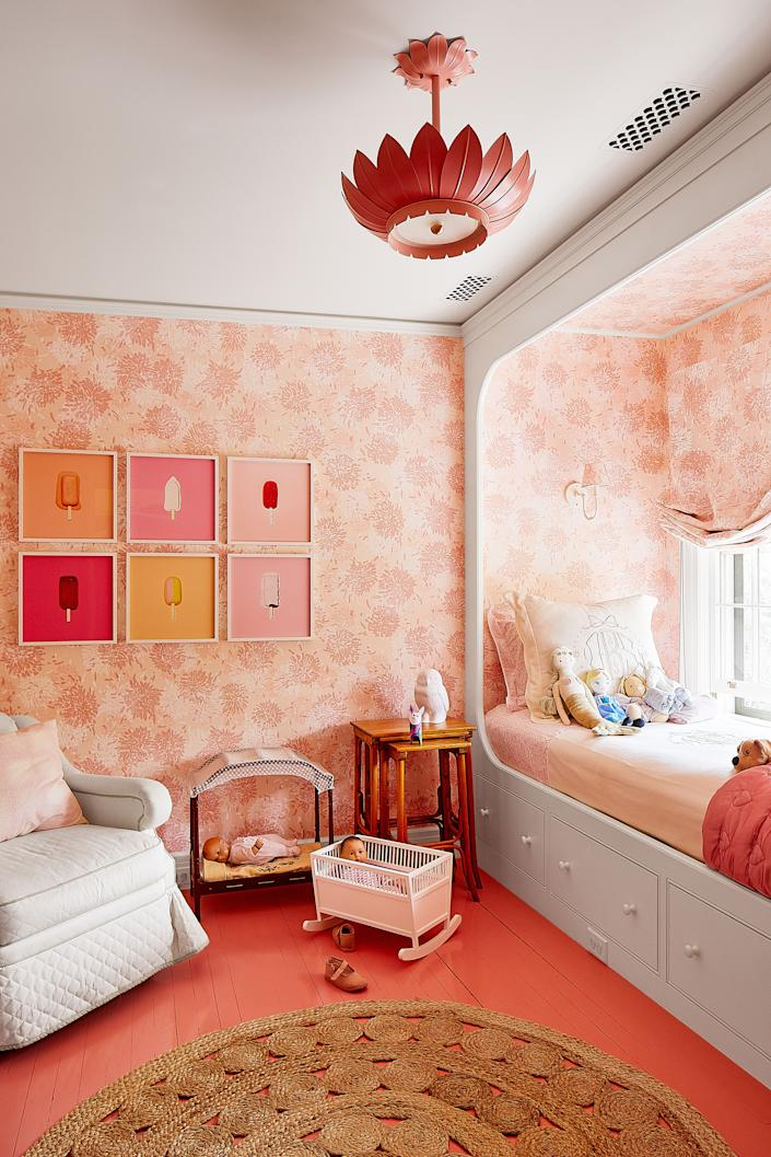 """<div class=""""caption""""> Delphine's room is wrapped in a custom-colored silk by <a href=""""http://t4fabrics.com/"""" rel=""""nofollow noopener"""" target=""""_blank"""" data-ylk=""""slk:Tillett Textiles"""" class=""""link rapid-noclick-resp"""">Tillett Textiles</a>. <a href=""""http://www.coleenandcompany.com/"""" rel=""""nofollow noopener"""" target=""""_blank"""" data-ylk=""""slk:Coleen & Co."""" class=""""link rapid-noclick-resp"""">Coleen & Co.</a> pendant; vintage nesting tables; artworks by Simone Rosenbauer. </div>"""