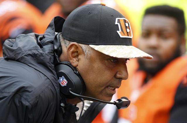 Cincinnati Bengals head coach Marvin Lewis talks on the sidelines in the first half of an NFL football game against the Cleveland Browns, Sunday, Nov. 17, 2013, in Cincinnati. (AP Photo/David Kohl)