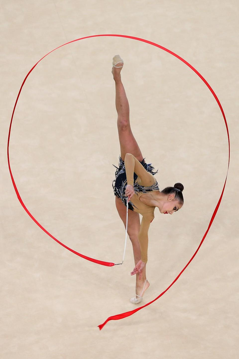 <p>Margarita Mamun of Russia competes during the Women's Individual All-Around Rhythmic Gymnastics Final on Day 15 of the Rio 2016 Olympic Games at the Rio Olympic Arena on August 20, 2016 in Rio de Janeiro, Brazil. (Photo by Alex Livesey/Getty Images) </p>
