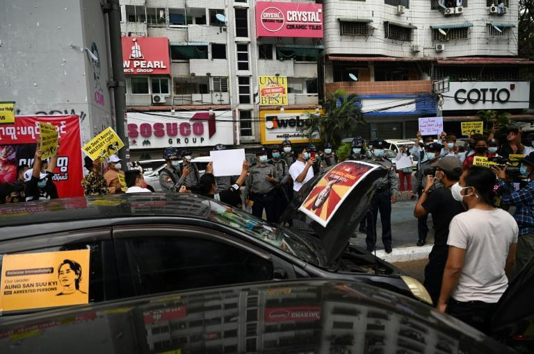 Pro-democracy protesters block a road with their cars, demanding the release of detained Myanmar's civilian leader Aung San Suu Kyi