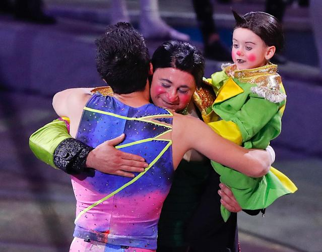 <p>Davis Vassallo, center, hugs a member of the trapeze troupe as he holds his daughter Adriana after the final show of the Ringling Bros. and Barnum & Bailey Circus, Sunday, May 21, 2017, in Uniondale, N.Y. (AP Photo/Julie Jacobson) </p>