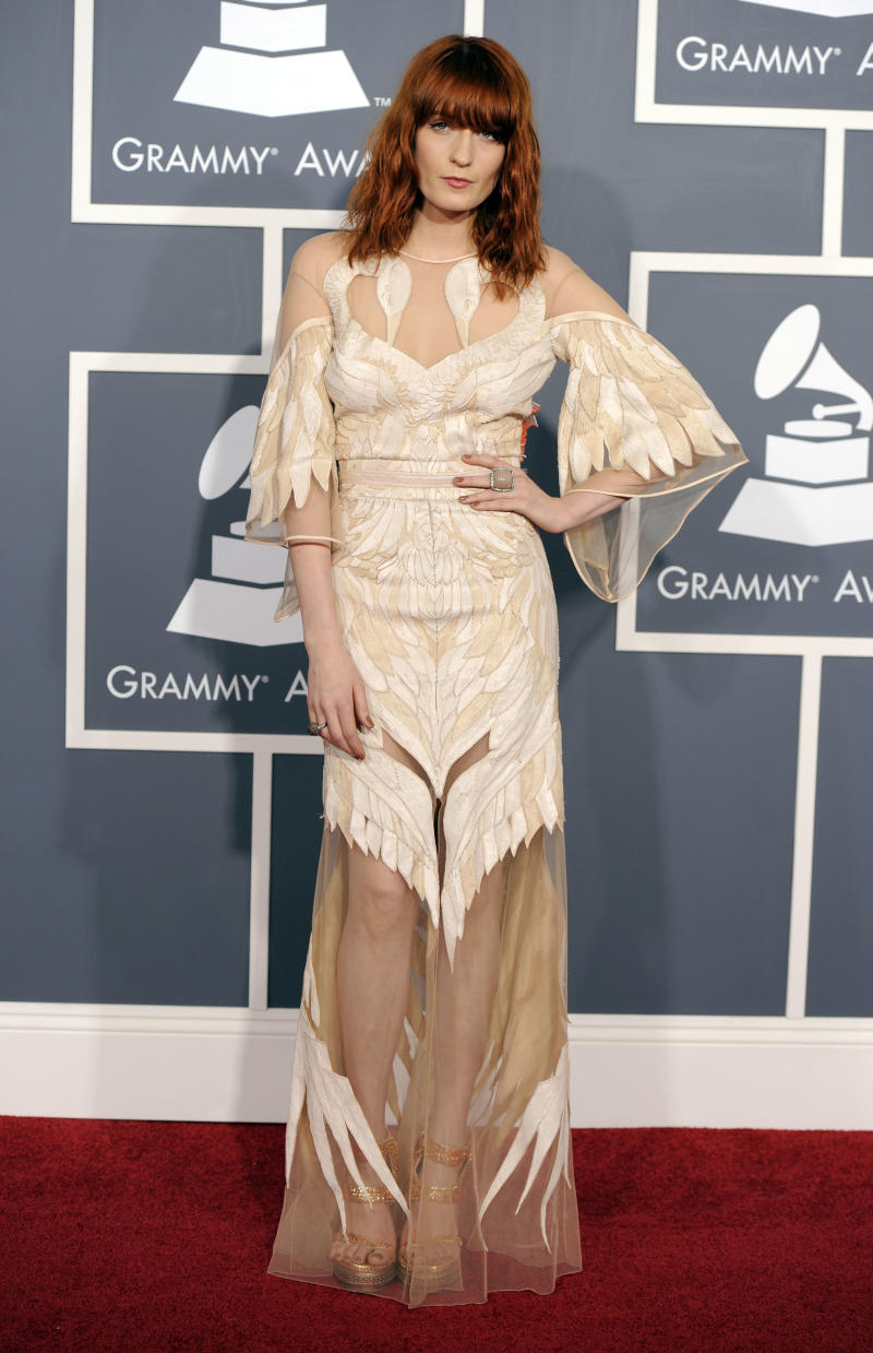 Florence Welch, of the band Florence and the Machine, arrives at the 53rd annual Grammy Awards on Sunday, Feb. 13, 2011, in Los Angeles. (AP Photo/Chris Pizzello)