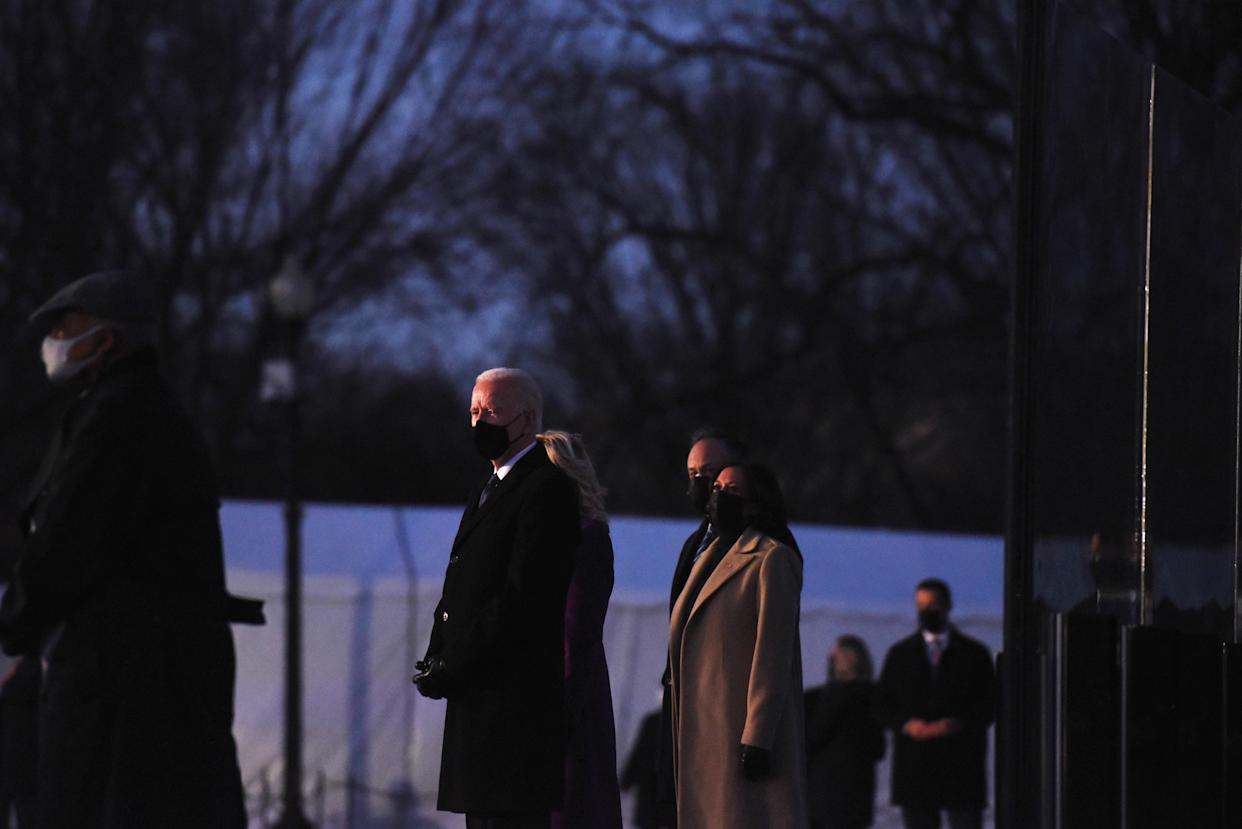 Joe Biden pauses at a memorial to honor those who died from complications due to the coronavirus at the Lincoln Memorial in Washington, D.C., Jan. 19. (Callaghan O'Hare/Reuters)